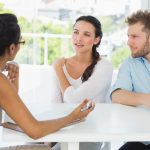 A couple in therapy wondering does couples counseling work.