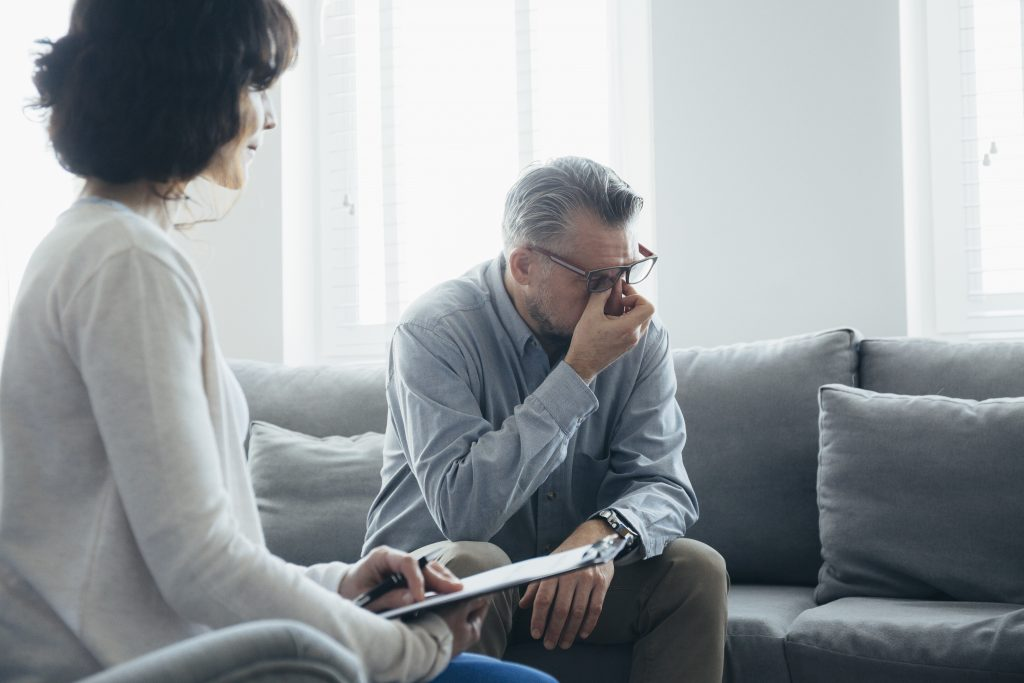 A man wondering how to talk to a therapist